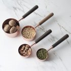 4Pcs/Set Household Kitchen Rose Gold Thicken Wooden Handle Copper Plating Measuring Spoons As shown